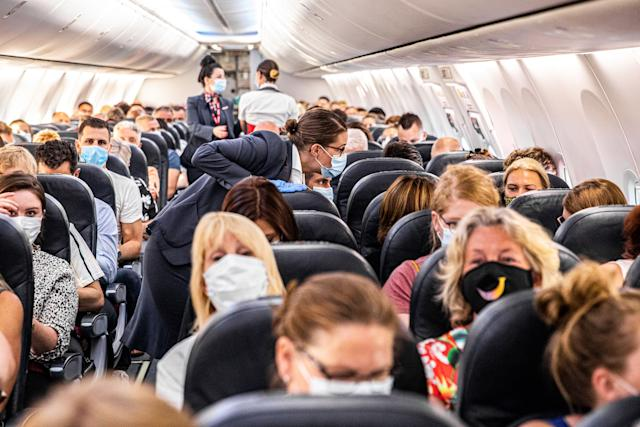 Passengers are welcomed on a Corendon plane departing from Amsterdam's Schiphol airport to Bulgaria's Burgas airport, on June 26, 2020, on the first holiday flight by the travel company since the novel coronavirus in March. (Photo by JEFFREY GROENEWEG/ANP/AFP via Getty Images)