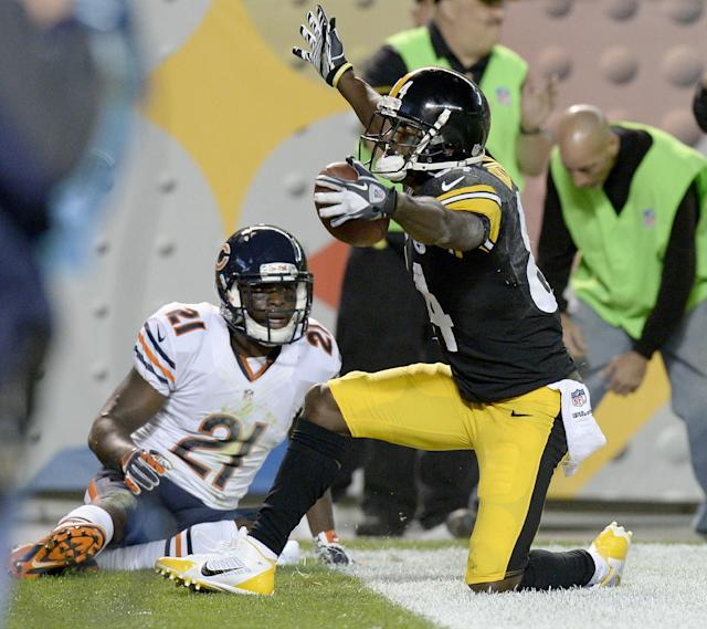 Pittsburgh Steelers wide receiver Antonio Brown (84) celebrates after making a touchdown catch in front of Chicago Bears strong safety Major Wright (21) in the second quarter of an NFL football game on Sunday, Sept. 22, 2013, in Pittsburgh. (AP Photo/Don Wright)