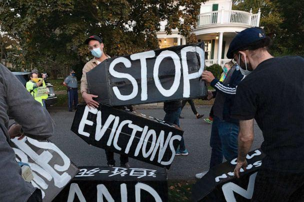 Housing activists erect a sign in Swampscott, Massachusetts, on Oct. 14, 2020. The Biden administration on July 29, 2021 called on Congress to extend a federal freeze on evictions set to expire on Saturday, arguing its hands are tied by the Supreme Court. (Michael Dwyer/AP)