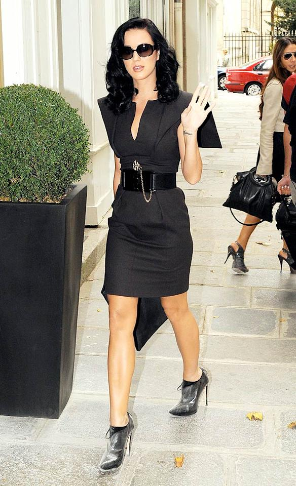 "Speaking of head-turners, Katy Perry debuted a sophisticated look en route to a Chanel fashion show in Paris. Her dark taupe Karl Lagerfeld frock and wide belt were uncharacteristic for the singer who typically sports funky garb. <a href=""http://www.x17online.com"" target=""new"">X17 Online</a> - October 3, 2009"