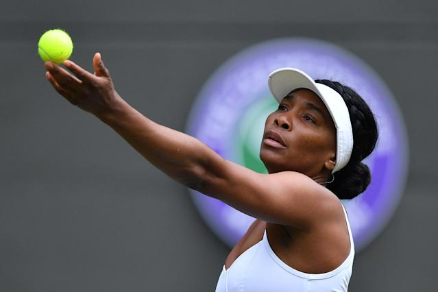 US player Venus Williams serves to US player Cori Gauff during their women's singles first round match on the first day of the 2019 Wimbledon Championships at The All England Lawn Tennis Club in Wimbledon, southwest London, on July 1, 2019. (Photo by Ben Stansall/AFP/Getty Images)
