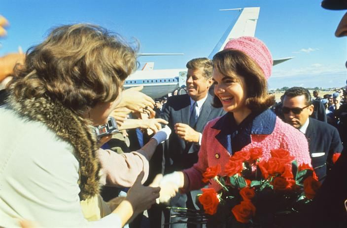 President John F. Kennedy and his wife, Jackie, greet a crowd at Love Field in Dallas upon arrival for a campaign tour on the day of JFK's assassination. (Photo: Art Rickerby/The Life Picture Collection/Getty Images)