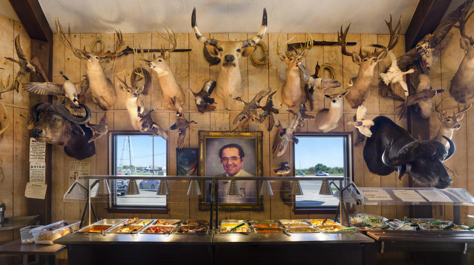 <p>Documenting our American culture through our roadside landscape, I found this curious juxtaposition while looking for lunch in rural Texas, the heart of hunting country. Mikeska's Bar-B-Q is famous for it's Sunday BBQ buffet and its taxidermy. Authentic to the scene depicted, this highly-detailed image is constructed of over 100 individual photographs meticulously stitched together. (Richard Frishman, United States, Winner, Open Still Life and Winner, United States National Award, 2018 Sony World Photography Awards) </p>