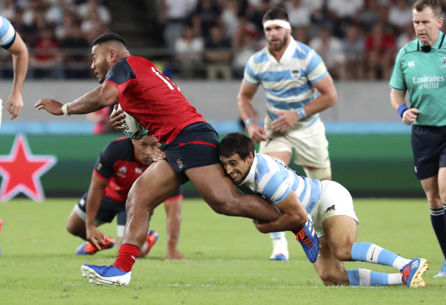 England's Manu Tuilagi makes a break upfield during the Rugby World Cup Pool C game at Tokyo Stadium between England and Argentina in Tokyo, Japan, Saturday, Oct. 5, 2019. (AP Photo/Eugene Hoshiko)