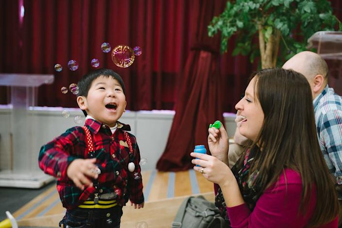 """""""Anna-Marie and Brian were in Korea to meet their second son,<a href=""""http://www.welkinlight.com/tobins-adoption-korea-photographer/"""" target=""""_blank"""">Tobin, for the first time</a>...Clearly a loving little man, it didn't take him long to give his dad a big kiss on the cheek, get swept up in hugs, or share a drink with his mother."""" --Dylan Goldby"""
