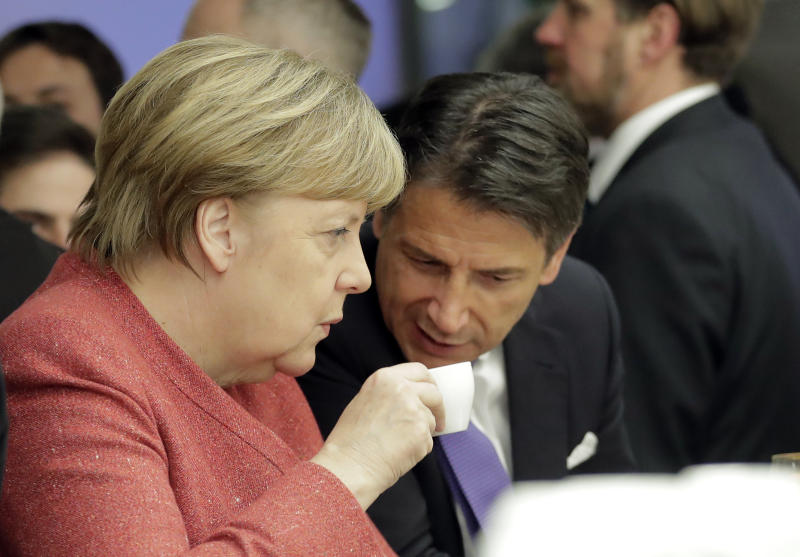 German Chancellor Angela Merkel talks with Italian Prime Minister Giuseppe Conte over a coffee at the annual meeting of the World Economic Forum in Davos, Switzerland, Wednesday, Jan. 23, 2019. (AP Photo/Markus Schreiber)