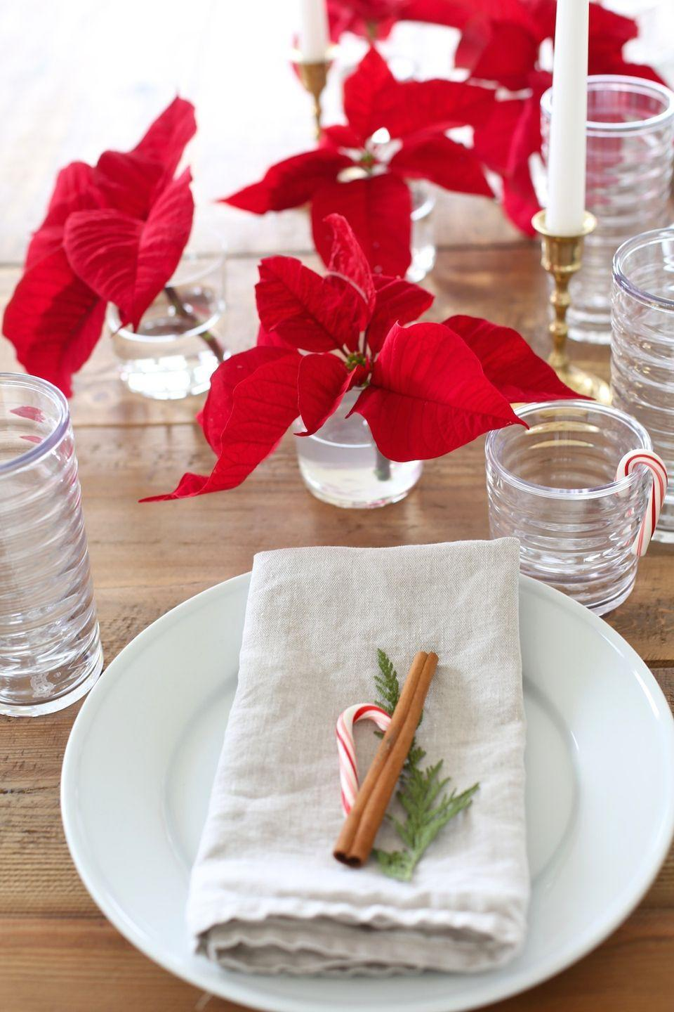 "<p>Poinsettias, cinnamon, and candy canes will literally never go out of style.</p><p>See more at <a href=""http://julieblanner.com/poinsettia-centerpiece/"" rel=""nofollow noopener"" target=""_blank"" data-ylk=""slk:Julie Blanner"" class=""link rapid-noclick-resp"">Julie Blanner</a>. </p>"