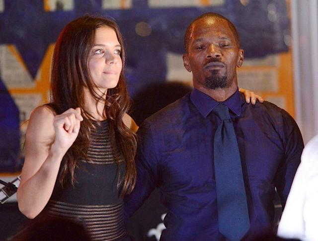 Katie Holmes and Jamie Foxx first got people talking when they were thisclose at a benefit in the Hamptons in August 2013. (Photo: Shahar Azran/WireImage)