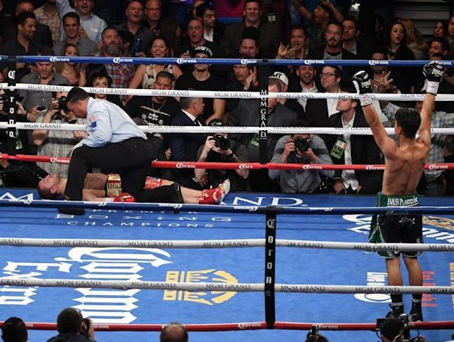 Mikey Garcia (R) celebrates as referee Tony Weeks checks on Dejan Zlaticanin after Garcia knocked him out in the fourth round of the WBC lightweight title fight Jan. 28 in Las Vegas. Garcia will next fight Adrien Broner on July 29. (Getty Images)