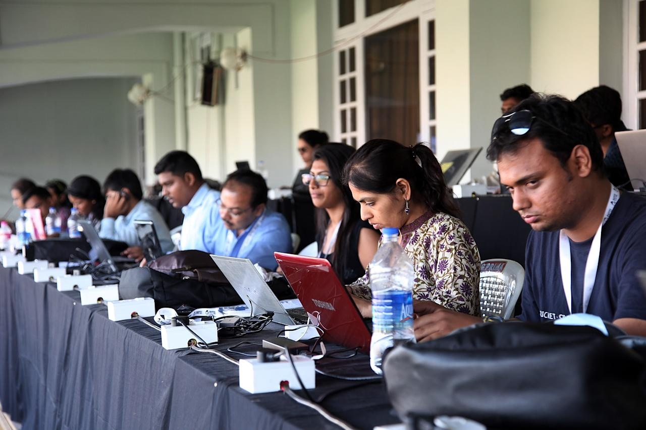MUMBAI, INDIA - FEBRUARY 17: Journalists working in the press tribune during the final between Australia and West Indies of the Women's World Cup India 2013 played at the Cricket Club of India ground on February 17, 2013 in Mumbai, India. (Photo by Graham Crouch/ICC via Getty Images)