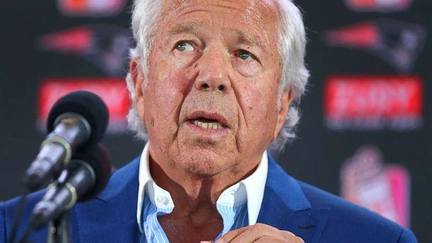 PHOTO: New England Patriots owner Robert Kraft holds a medal containing a wedding photo of him and his late wife Myra at a press conference in Foxborough, Mass., Aug. 9, 2017. Kraft said he wore if for 11 months straight after she died. (Boston Globe via Getty Images, FILE)