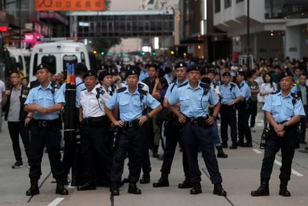 Police stand guard at Hong Kong's tourism district Tsim Sha Tsui during anti-extradition bill protest
