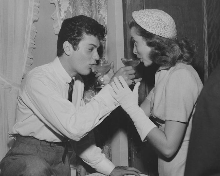 <p>Tony Curtis and Janet Leigh sip from coups of celebratory champagne after their 1951 ceremony. The Hollywood stars were married in an intimate service in Greenwich, Connecticut. </p>