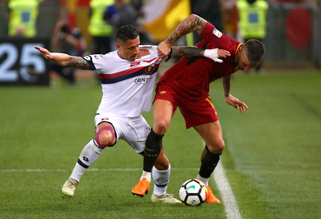 Soccer Football - Serie A - AS Roma vs Genoa - Stadio Olimpico, Rome, Italy - April 18, 2018 Roma's Aleksandar Kolarov in action with Genoa's Gianluca Lapadula REUTERS/Alessandro Bianchi