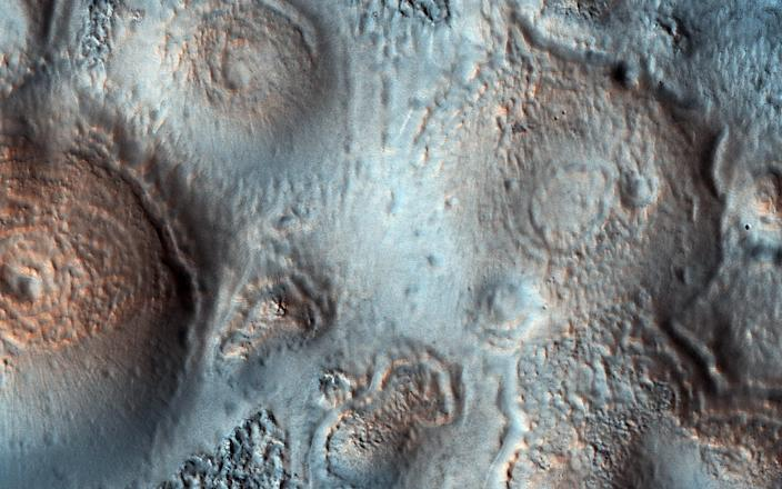 "Relatively bright mounds scattered throughout darker and diverse surfaces on Mars, May 15, 2018. <p class=""copyright"">NASA/JPL-Caltech/Univ. of Arizona</p>"