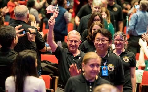 Alan Stern, with New Horizons team members  - Credit: AFP