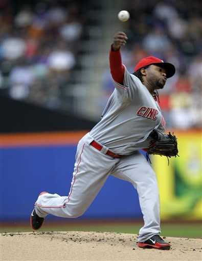 Cincinnati Reds starting pitcher Johnny Cueto delivers in the first inning against the New York Mets during their baseball game at Citi Field in New York, Sunday, June 17, 2012. (AP Photo/Kathy Willens)