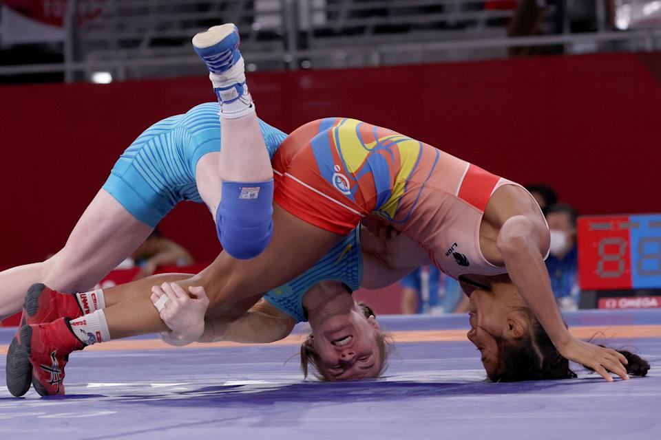 <p>Ecuador's Lucia Yamileth Yepez Guzman (red) wrestles Kazakhstan's Valentina Ivanovna Islamova in their women's freestyle 50kg wrestling early round match during the Tokyo 2020 Olympic Games at the Makuhari Messe in Tokyo on August 6, 2021. (Photo by Jack GUEZ / AFP)</p>