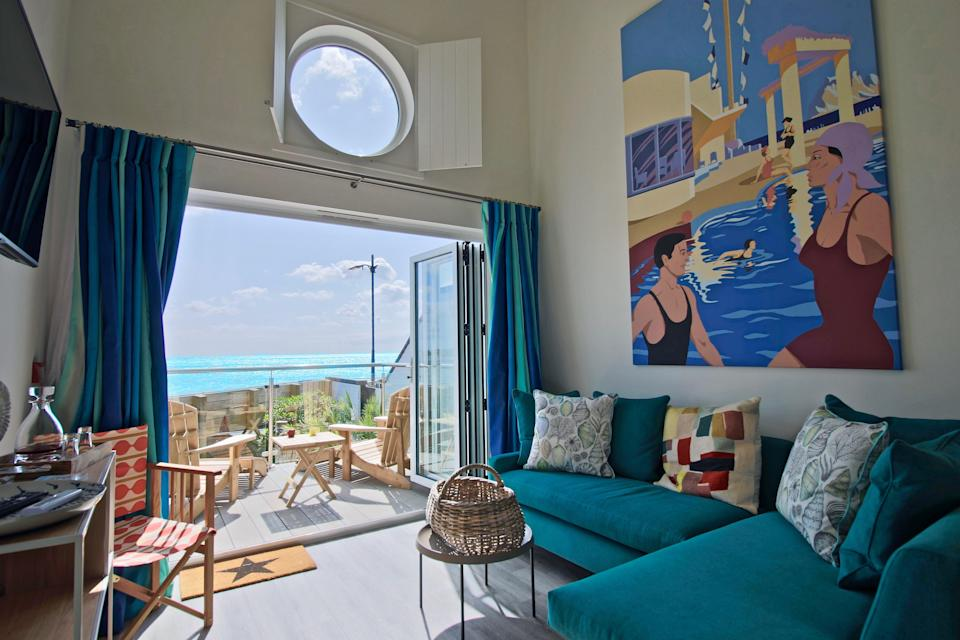 <p>Beachcroft Beach Hut Suites look out onto pebbly Felpham Beach in West Sussex</p> (Beachcroft)
