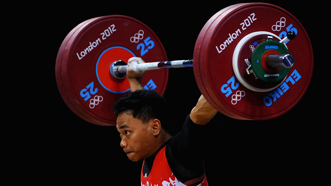 LONDON, ENGLAND - JULY 30:  Irawan Eko Yuli of Indonesia competes during the Men's 62kg Weightlifting on Day 3 of the London 2012 Olympic Games at ExCeL on July 30, 2012 in London, England.  (Photo by Laurence Griffiths/Getty Images)