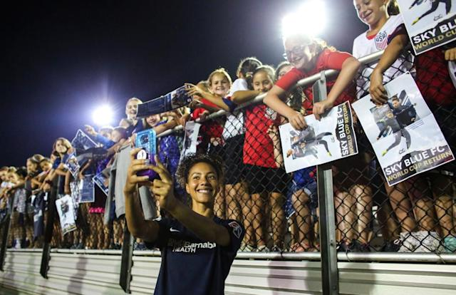 "<span class=""element-image__caption"">Sky Blue defender Estelle Johnson takes a selfie with young fans after a July match against the Washington Spirit in Piscataway, New Jersey.</span> <span class=""element-image__credit"">Photograph: Kena Betancur/AFP/Getty Images</span>"
