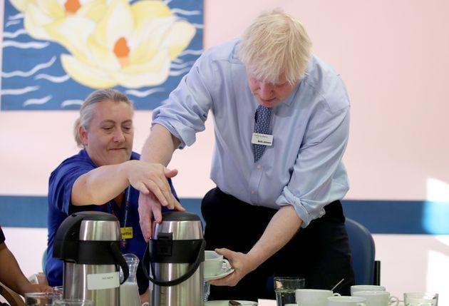 Prime Minister Boris Johnson meets members of staff during a visit to Whipps Cross University Hospital in Leytonstone, east London.
