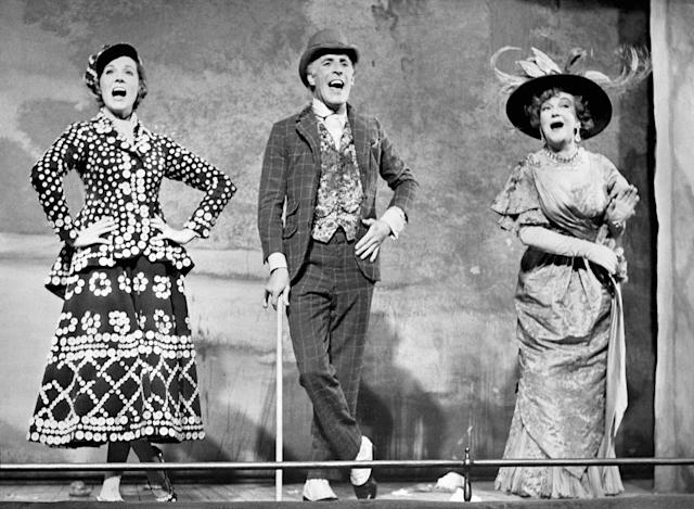 <p>Sir Bruce Forsyth with Beryl and Julie singing 'Piccadilly,' on stage at the old Brixton Music Hall in 1967. (PA) </p>