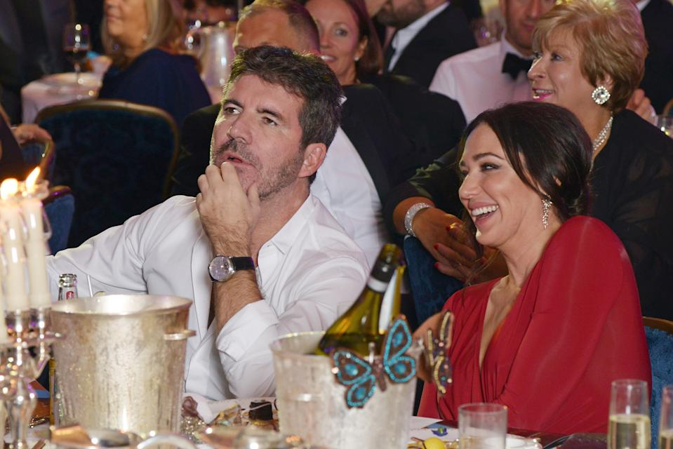 LONDON, ENGLAND - OCTOBER 03:  Simon Cowell (L) and Lauren Silverman attend The Shooting Star Chase Ball at The Dorchester on October 3, 2015 in London, England.  (Photo by Dave J Hogan/Dave J Hogan/Getty Images)