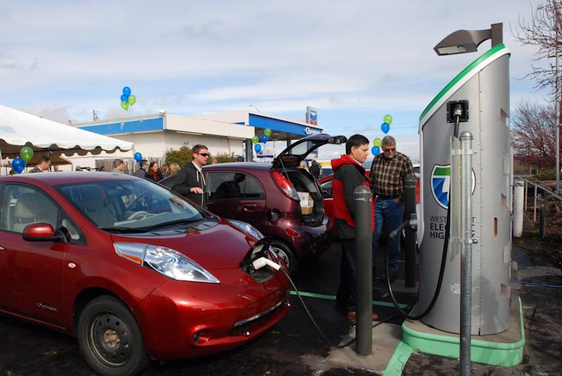 Tucked in a back corner of a gas station, a Nissan Leaf tops off it's battery Friday, March 16, 2012 at one of the new charging stations now open to the public along a 160-mile stretch of Interstate 5. Eight new charging stations equipped with fast- and medium-speed chargers make it possible for electric cars to cruise from the California border to Eugene, Ore., recharging in about 20 minutes when their batteries get low. It is the first major section of an Electric Highway that will allow electric cars to cruise from Canada to Mexico. (AP Photo/Jeff Barnard)