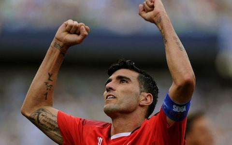 Sevilla's forward Jose Antonio Reyes celerates after scoring during the Spanish league football match Malaga CF vs Sevilla FC - Credit: Cristina Quicler / AFP