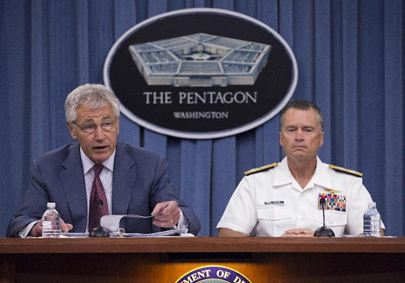 Defense Secretary Chuck Hagel, accompanied by Joint Chiefs Vice Chairman Adm. James Winnefeld, speaks during a news conference at the Pentagon, Wednesday, July 31, 2013. Hagel warned that the Pentagon may have to mothball up to three Navy aircraft carriers and order more sharp reductions in the size of the Army and Marine Corps if Congress does not act to avoid massive budget cuts beginning in 2014. (AP Photo/Evan Vucci)