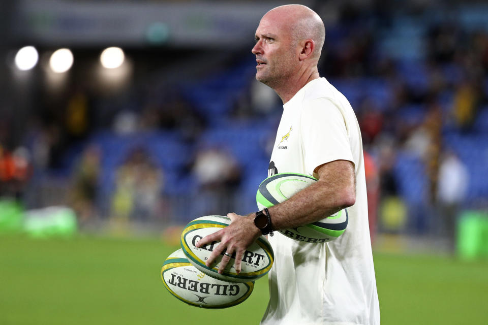 South Africa's head coach Jacques Nienaber collects balls as his team warms up ahead of their Rugby Championship match against Australia on Sunday, Sept. 12, 2021, Gold Coast, Australia. (AP Photo/Tertius Pickard)