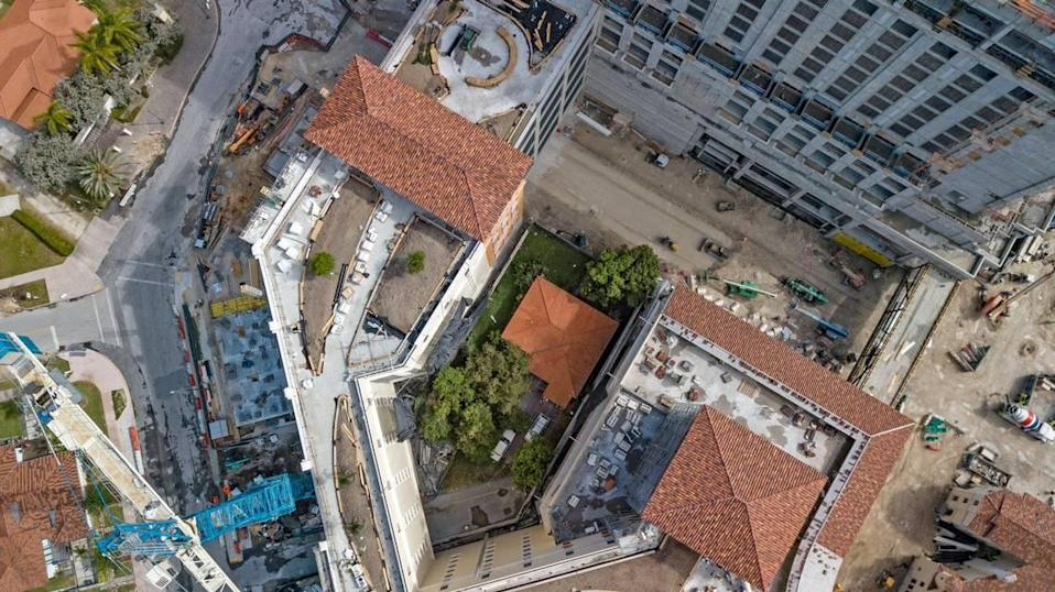 Orlando Capote's house is surrounded by The Plaza Coral Gables, a $600 million mixed-used mini city that will encompass 1.1 million square feet of apartments, offices, shops, restaurants, parking garages and a hotel.