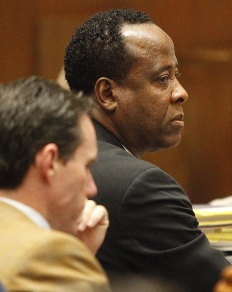Conrad Murray with Defense Attorney Edward Chernoff  looks on during the Conrad Murray involuntary manslaughter trial in downtown Los Angeles, Friday, Sept. 30, 2011. Murray has pleaded not guilty and faces four years in prison and the loss of his medical license if convicted of involuntary manslaughter in Michael Jackson's death.   (AP Photo/Al Seib, Pool)