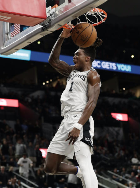 San Antonio Spurs guard Lonnie Walker IV dunks against the Houston Rockets during the second half of an NBA basketball game in San Antonio, Tuesday, Dec. 3, 2019. San Antonio won 135-133 in double overtime. (AP Photo/Eric Gay)