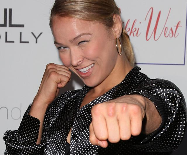 """PASADENA, CA - AUGUST 01: Mixed martial artist Ronda Rousey attends the grand opening and fashion show for Nicole Winnaman's new boutique """"Nikki West"""" at Nikki West Boutique on August 1, 2012 in Pasadena, California. (Photo by David Livingston/Getty Images)"""