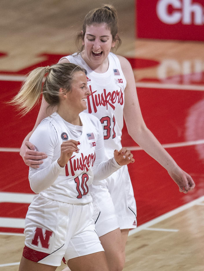 Nebraska's Whitney Brown (10) celebrates her second three-point basket against Northwestern in the first half with teammate Kate Cain (31) during an NCAA college basketball game Thursday, Dec. 31, 2020, in Lincoln, Neb. (Francis Gardler/Lincoln Journal Star via AP)