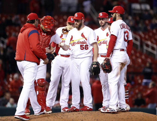 Cardinals reliever Greg Holland is removed by manager Mike Matheny during the 10th inning of Monday's game against the Brewers. (AP Photo)