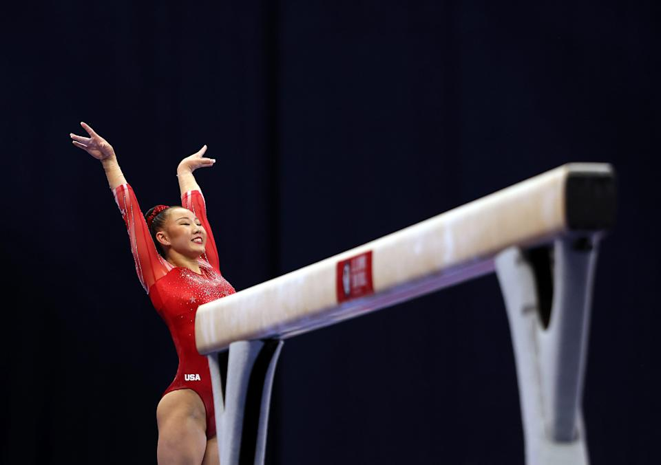 Kara Eaker smiles after landing her dismount off the balance beam during the 2021 U.S. Gymnastics Olympic Trials at America's Center on June 25, 2021 in St Louis, Missouri.