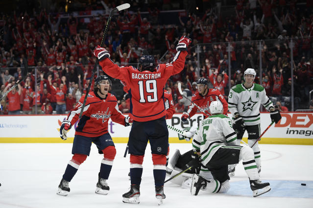 Washington Capitals center Nicklas Backstrom (19), of Sweden, celebrates his goal with T.J. Oshie, left, during the third period of an NHL hockey game as Dallas Stars defensemen John Klingberg (3) and Andrej Sekera (5) look on, Tuesday, Oct. 8, 2019, in Washington. The Stars won 4-3 in overtime. (AP Photo/Nick Wass)