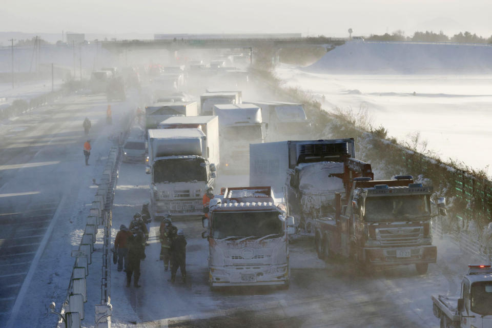 Cars are stuck on the snowy Tohoku Expressway in Osaki, Miyagi prefecture, northern Japan, after a multiple accident, Tuesday, Jan. 19. 2021. (Yusuke Ogata/Kyodo News via AP)