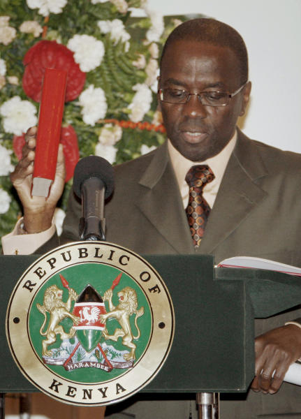 FILE - In this Monday, June 20, 2011 file photo, Dr. Willy Mutunga takes the oath of office as the new Chief Justice during the swearing-in ceremony at State House in Nairobi, Kenya. Mutunga is making an extraordinary public statement that he will not be cowed by threats and harassment ahead of the country's March 4 election, after receiving a threatening letter warning of dire consequences if the courts rule against the eligibility of two leaders who are facing trial at the International Criminal Court. (AP Photo, File)
