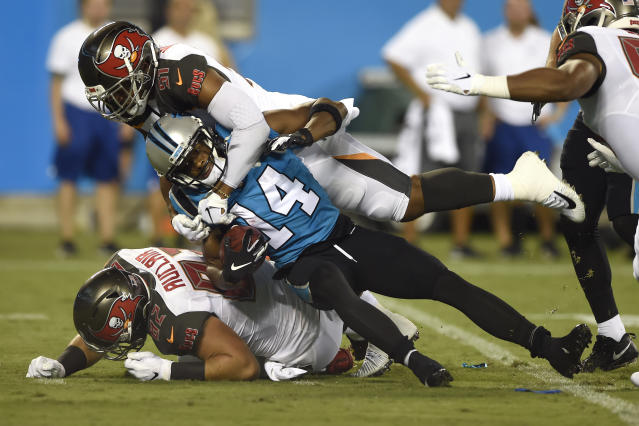 Tampa Bay Buccaneers linebacker Kevin Minter, top, and tight end Antony Auclair (82) tackle Carolina Panthers wide receiver Ray-Ray McCloud (14) during the first half of an NFL football game in Charlotte, N.C., Thursday, Sept. 12, 2019. (AP Photo/Mike McCarn)