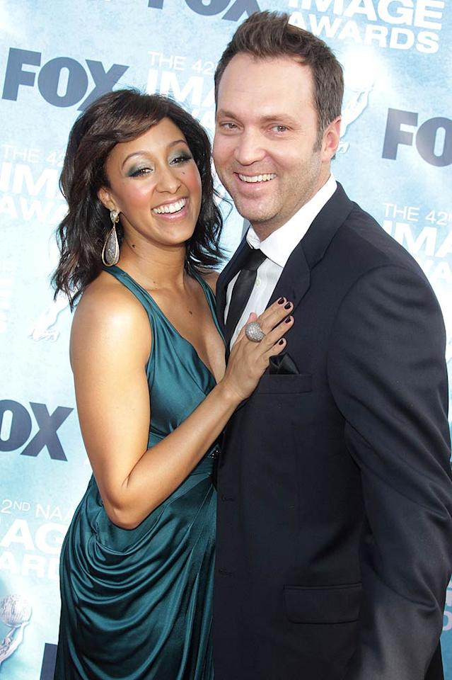 """Remember how adorable Tamera Mowry and her twin sister Tia were on their '90s sitcom """"Sister, Sister""""? She's all grown up now! The actress said """"I do"""" to her honey, Fox News Channel correspondent Adam Housley, in Napa Valley, California, on May 15. And don't worry -- her sister was still by her side as matron of honor. (She married actor Cory Hardrict in 2008.)"""
