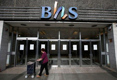 FILE PHOTO: A woman walks past the Wood Green branch of department store chain BHS, after its final closure, in London, Britain August 28, 2016.  REUTERS/Peter Nicholls/File Photo