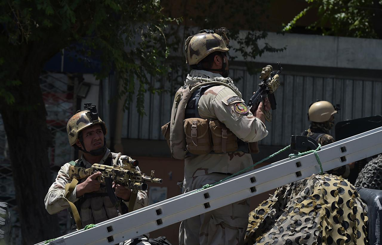 "<p>Afghan security forces keep watch at the site of a suicide blast near Iraq's embassy in Kabul on July 31, 2017.<br /> A series of explosions and the sound of gunfire shook the Afghan capital on July 31, with a security source telling AFP that a suicide bomber had blown himself up in front of the Iraqi embassy. ""Civilians are being evacuated"" from the area as the attack is ongoing, said the official, who declined to be named.<br /> (Shah Marai/AFP/Getty Images) </p>"