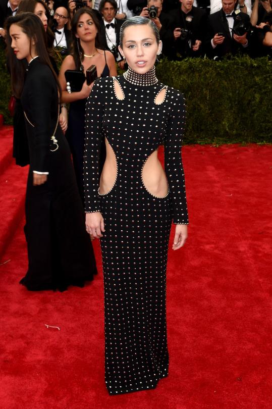 <p>Miley's heavy metal cutout Alexander Wang dress would've been perfect for the PUNK exhibit the Met held just last year. We know Miley likes to ruffle feathers but this look still left us wanting more (and that's not to say that we don't love it).</p>