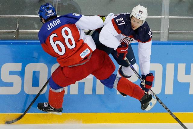 Czech Republic forward Jaromir Jagr and USA defenseman Ryan McDonagh collide during the first period of men's quarterfinal hockey game in Shayba Arena at the 2014 Winter Olympics, Wednesday, Feb. 19, 2014, in Sochi, Russia. (AP Photo/Matt Slocum)