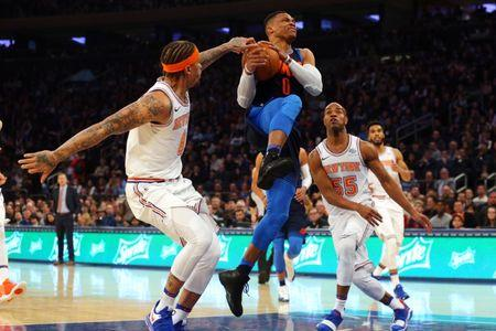 Dec 16, 2017; New York, NY, USA; Oklahoma City Thunder point guard Russell Westbrook (0) drives to the basket against New York Knicks small forward Michael Beasley (8) and point guard Jarrett Jack (55) during the first quarter at Madison Square Garden. Mandatory Credit: Brad Penner-USA TODAY Sports