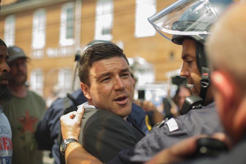 Jason Kessler is forcibly removed by Virginia state police during an attempted press conference in the wake of a deadly white supremacist rally in Charlottesville.